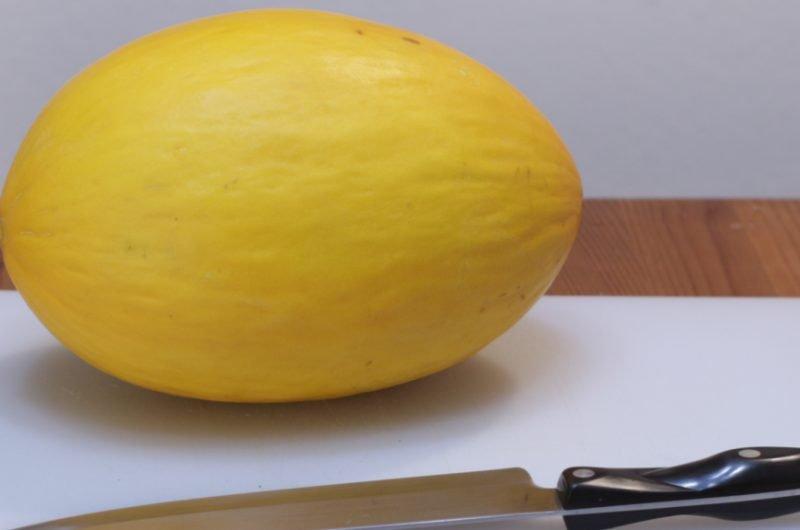 Canary melon on a cutting board