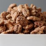 candied pecans in a white dish