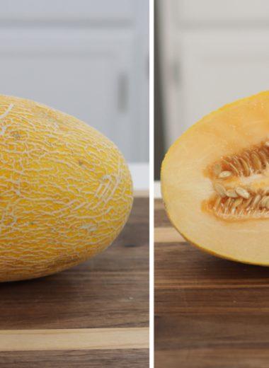 Hami melon cut in half on a cutting board