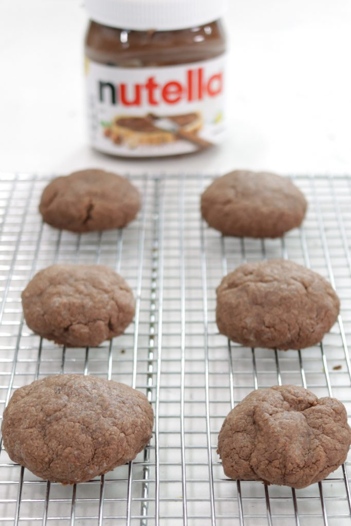 Batch of Nutella cookies on a wire rack.