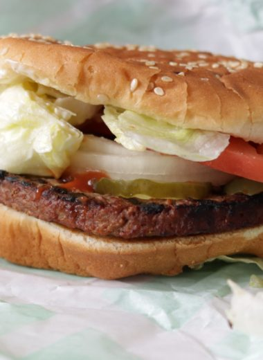 An Impossible whopper sitting in its wrapper.