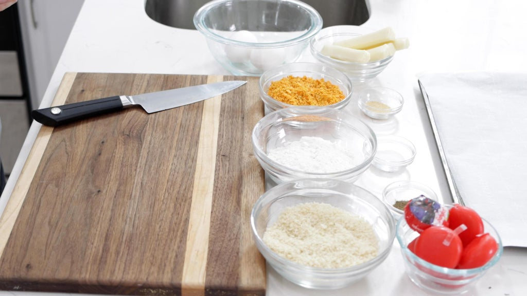 Several ingredients in bowls on a white countertop.