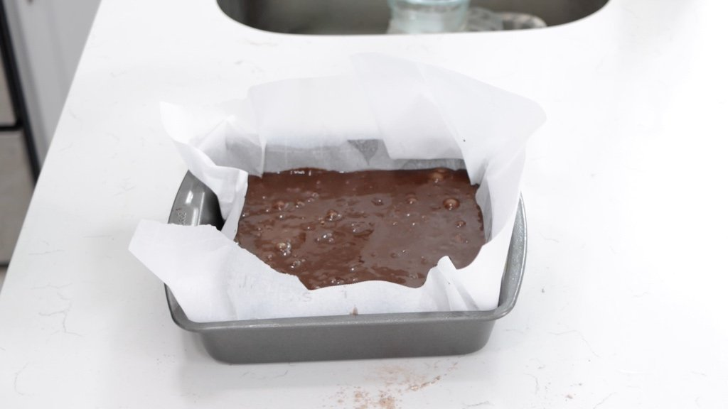 Baking pan filled with fudgy brownie batter.