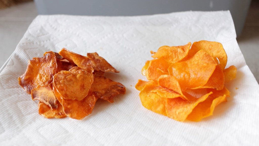 Two piles of sweet potato chips on a plate.