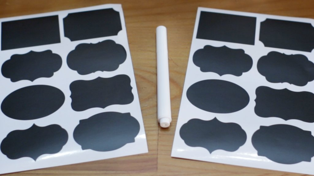 Set of black and white stickers on a wooden table.
