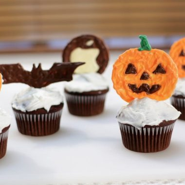 Halloween cupcake toppers on chocolate cupcakes.
