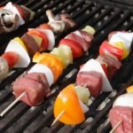 beef kabobs on a grill