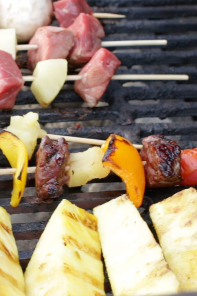 Beef kabobs cooking on a grill