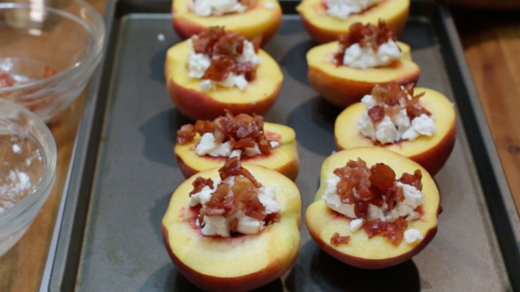 Prosciutto on top of goat cheese and peaches.