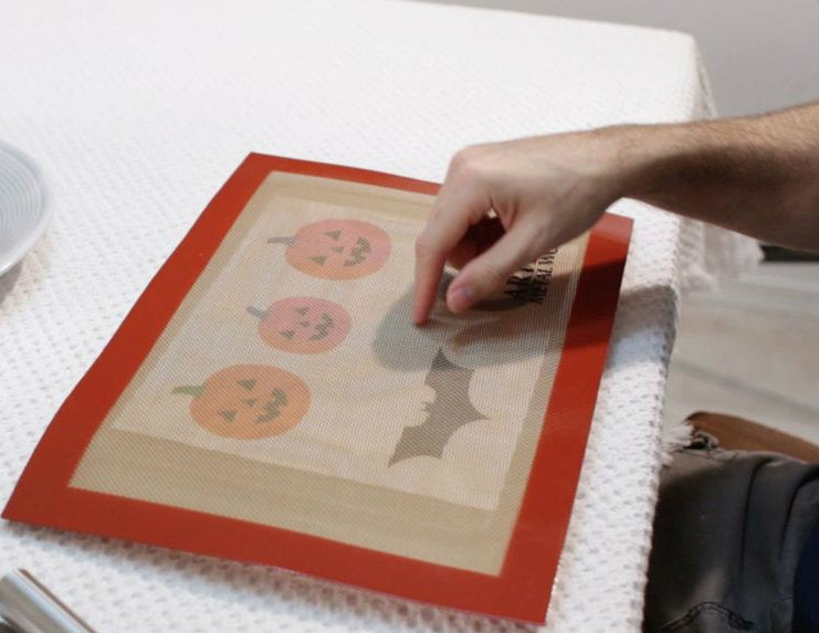 Silicone baking mat over halloween stencil
