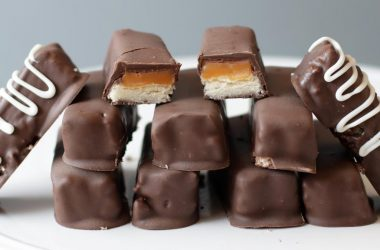 Stack of homemade Twix bars on a white plate