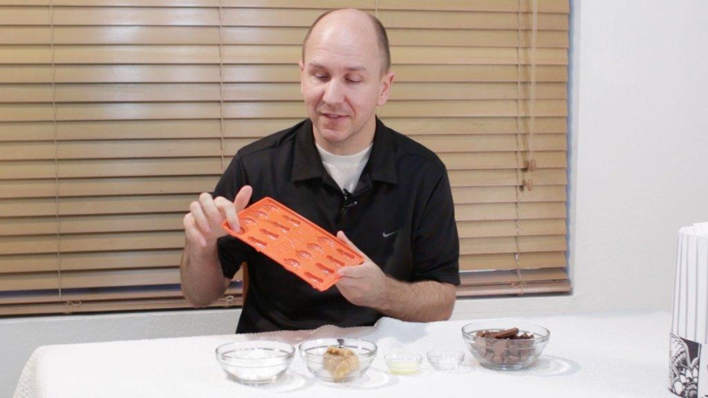 Matt holding a halloween chocolate mold.