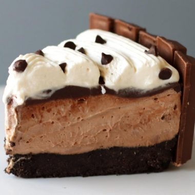 Slice of no-bake chocolate cheesecake on a white plate