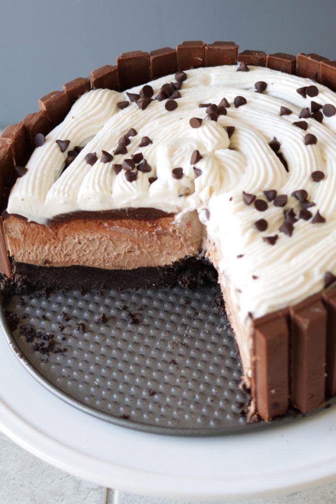 No bake chocolate cheesecake on a white plate.