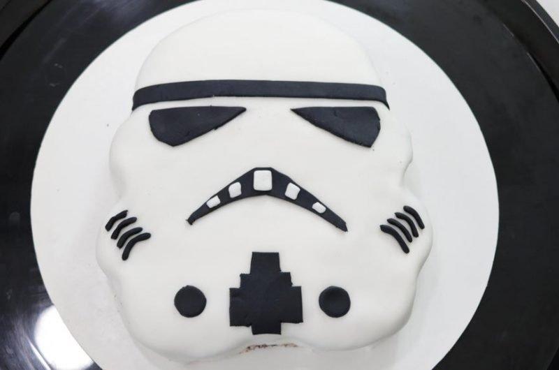 Star wars stormtrooper cake on a black plate