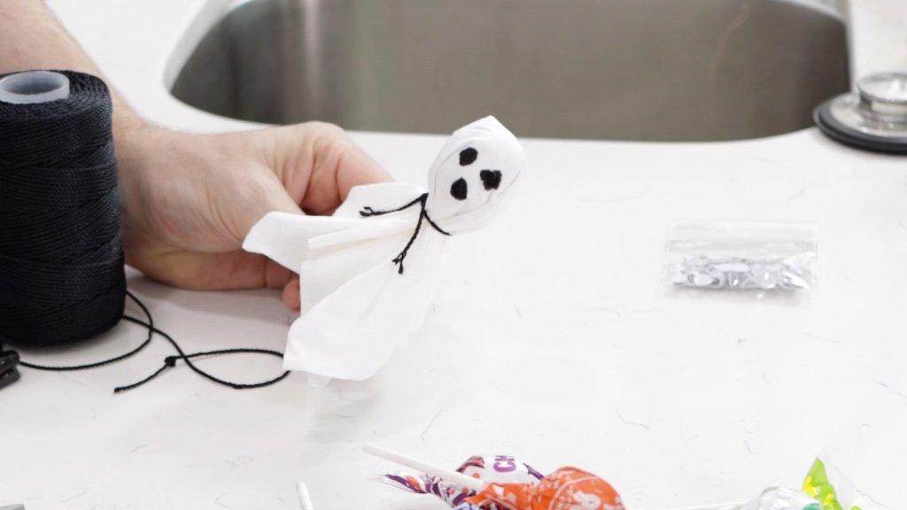 Hand holding a Halloween ghost pop