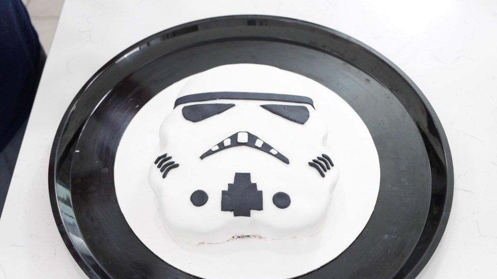 Finished Star Wars Cake Stormtrooper on a black plate